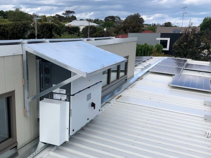 Solar inverters installed in protected area on roof